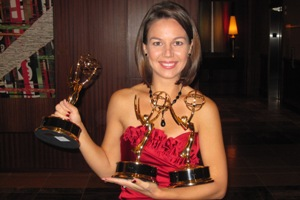 Janet Rodriguez holds her 3 Emmy Awards