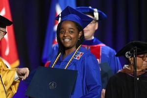 Samantha Miller accepts diploma