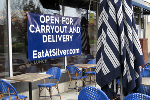 Open for carryout and delivery sign at Silver