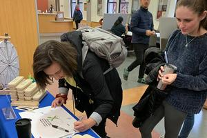 Students signing a pledge to not use single-use plastics