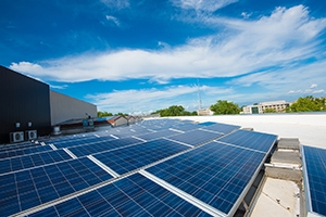 Solar panels on the roof of an AU building. As part of the carbon neutral plan, about 2,500 solar panels were installed on campus. AU also entered into a partnership to install solar panels in North Carolina.