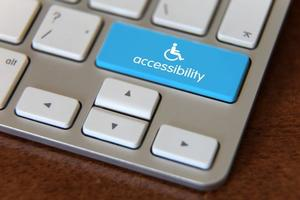 Laptop keyboard with accessibility button