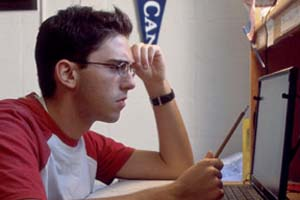 Student Studying with Laptop