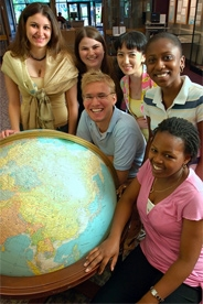 Students with world globe.