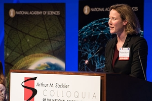Suhay giving a talk at the National Academy of Sciences about her new research project focused on communicating science.