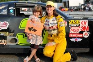 Sunny Hobbs poses with her daughter in front of her car.<br />(Photo credit: Lake Anna Photography by Lisa)
