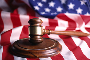 Photo of a gavel on an American flag.