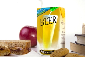 beer juice box, sandwich, books, and apple