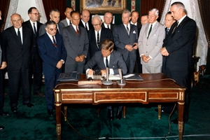 John F. Kennedy signs the limited nuclear test ban treaty