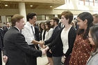 A photo of Canadian Prime Minister Justin Trudeau and American University President Neil Kerwin greeting AU students.