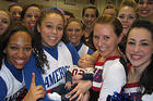 AU Spirit Program Cheerleaders and Dance Team babysit an Eagle in training.