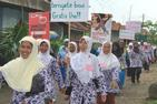 PEKKA Association in Brebes, Central Java, Indonesia, stages a parade announcing the PEKKA program and activities throughout their village.