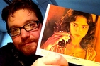 Kyle Brannon with a lobby card from the 1977 film Suspiria. It was a gift from a student in his European cinema class.