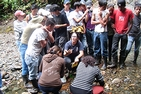 Karen Knee (center) teaching high school students in rural Ecuador about stream ecology.