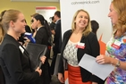 Student networking with alumni at the 2014 Accounting and Finance week.