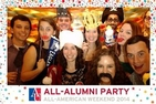 Alumni pose in a photo booth at the All-Alumni Party.
