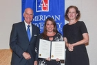 SPA Professor Jennifer Lawless, center, displays a copy of her American University award.