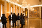 AU Gap Students participate in a private tour of the Russian Embassy in an opulent ballroom.