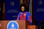Chimamanda Ngozi Adichie at podium at graduation