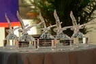Alumni Awards trophies on a table