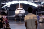 Blair Mason, 17, who dreams of becoming an astronaut, enters a hangar to see the retired space shuttle. Photo c/o David Ruck.