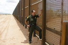 U.S. Customs and Border Protection officer stands at the Arizona section of the American border with Mexico.