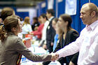 photo of employer and student at AU's fall Job and Internship Fair