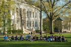 A group of students sit on the quad during  a peer mentor meeting.
