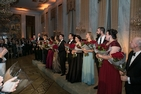 Performers from the joint concert of the Young Artist programs from the Washington National Opera (WNO) and the Bolshoi Theatre stand in front of audience holding flowers at the Russian Embassy
