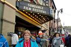 Cherry Graziosi standing in front of a movie theatre at the Sundance Film Festival