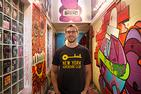 Man standing in hallway with colorful graffiti