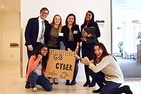 Six students on the Cyber Eagles team hold a sign that reads