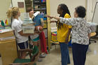 During the Freshman Service Experience in 2008, students helped teachers at Bancroft Elementary School get ready for the school year.