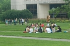 Students sitting in a circle on AU campus
