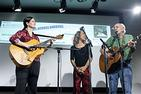 Laura DeNardis, Bethany and Peter Yarrow perform on stage.
