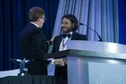 Hani Farsi accepts the Cyrus A. Ansary Award from Dr. Kerwin.