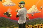 Album art from Tyler, the Creator's album Flower Boy; Man standing in a field of sunflowers surrounded by bees