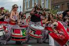 Batalá Washington, playing at the Funk Parade. Red, green, and white drums. Vibrant scene with all-female drum unit.