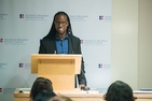 Professor Ibram Kendi stands at podium, announcing his vision for AU's Antiracism Research and Policy Center.