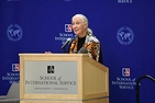 Jane Goodall speaks behind School of International Service podium.