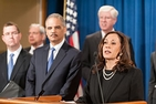 Senator Kamala Harris, right, flanked by former Attorney General Eric Holder and others.