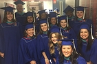 Students from the first graduating class for the online Public Administration and Policy program.