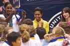 Michelle Obama with Olympian Lisa Leslie and Samantha Cameron, wife of British prime minister David Cameron.