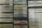 Three stacks of CDs in the Music Library
