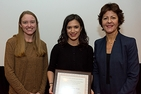 Nicole Caporino receives her award from Katherine Baucom and Michelle Craske