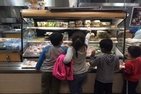 DC elementary schoolchildren reach for healthy lunch options.