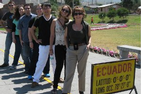 Students in Ecuador straddle the equator with Professor Maria Donoso-Clark in front.