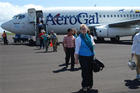 SIS Galapagos Summer Program students disembark from an airliner.
