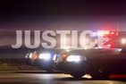 The word Justice superimposed on two police cars