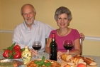 Alumni Board member Sara Nieves-Grafals and her husband, Al Getz, coauthored a travel cookbook together.